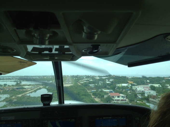 Wheels dowbn, landing strip ahead. The view out the window as we flew to Ambergris Caye from Belize City.