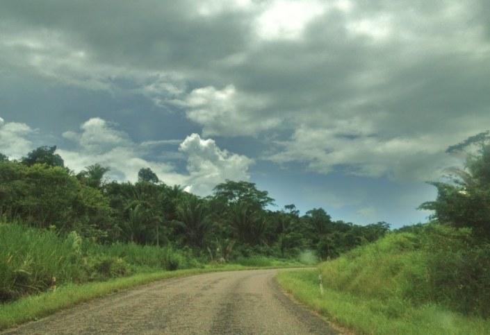 Heading north on the Hummingbird Highway, bracing for the rain.