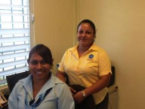 Our new bankers! Amalia Quiroz and Lovelia Seguro at the local branch of Atlantic International Bank.