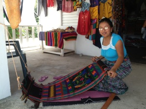 Dodi creates beautiful tapestries on her loom. Each takes 6-8 hours. She did not mention having property in Placencia for sale.