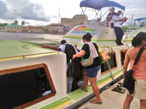 On board the Belize Express water taxi to Caye Cauker and San Pedro. The 4:30 pm boat, second last of the day was jam-packed. The young man to Rose's left is a student who commutes from San Pedro to Belize City by boat every day to attend school.