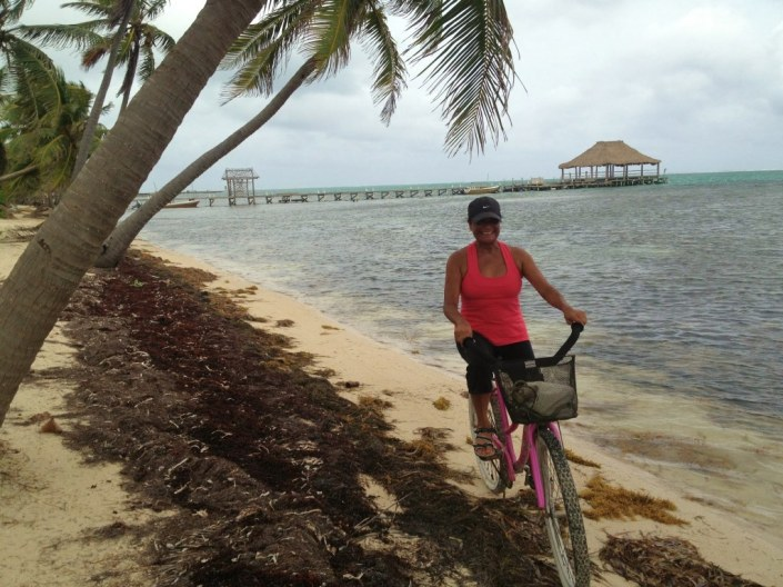 Cycling on the thin strip ob beach north of San Pedro on Ambergris Caye in Belize.