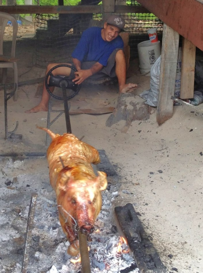 This is Andy. He sits in an alley next to La Cubana restaurant and slowly turns the pig on the spit. He says it takes 4-5 hours of slow turning to cook the pig just right.