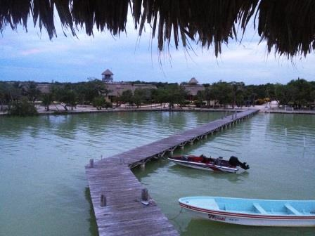 View of Orchid Bay resort from the palapa at the end of the pier. Our casita is just past the first row of trees at the end of the pier.