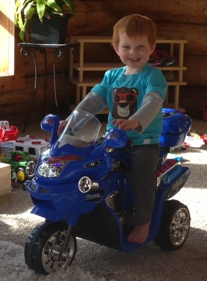 Brody tries out his new motorcycle around the livingroom ... and around ... and around ...and around ....