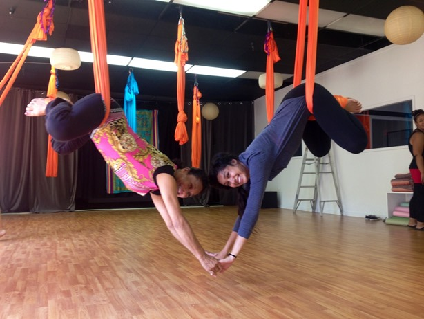 What does Rose do when she isn't teaching Pilates or yoga? Stuff like this: Hanging yoga with daughter, Caira.