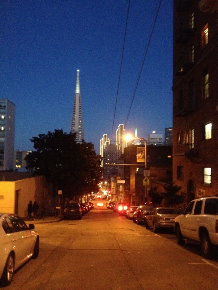 View of the Trans-America Building down a side street off Powell on Christmas evening in San Francisco. It looks like the tallest Christmas tree in the world.