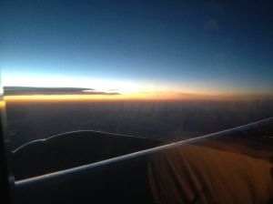 In the air, headed east into the rising sun, a few hours away from Dallas-Ft. Worth. Love the colors in the sky!