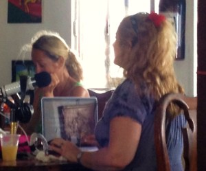 Paris Hilton-like celebrity watch: Peering through to door of Estel's on a sunny Saturday afternoon we found local San Pedro Scoop impresario Rebecca (left) and San Ignacio real estate/media maven Macarena Rose hard at work -- munching down on BBQ. They were among several high-profile judges for a local Q-off!