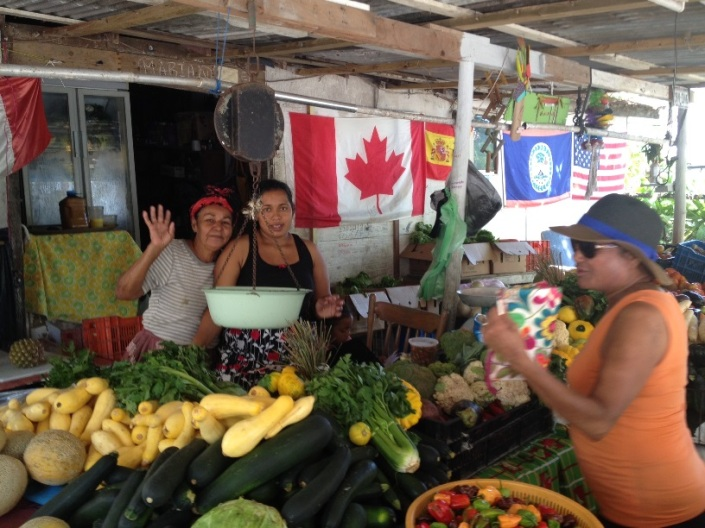 MMaria gives a little wave between waiting on customers, like Rose, at right, this morning.