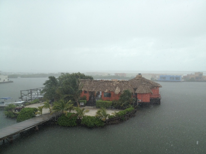 It may be a little hard to tell, but it is raining like crazy this afternoon. The house in the far right corner is having a party with balloons, a DJ and lots of outdoor seating. The sun is back out, the party is on track and we're listening to island tunes rolling across the lagoon.