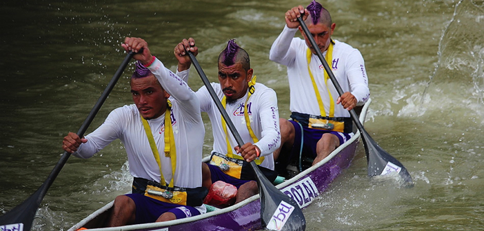 Dig in: Competitive paddlers go all out during the four-day, 170-mile La Ruta Maya River Challenge in Belize. Photo from the Ka'ana Resort in San Ignacio.