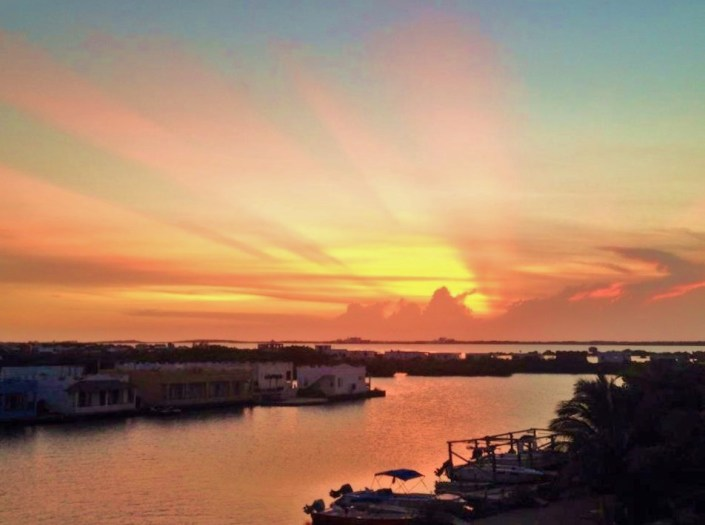 Bliss in Belize: Sunday's sunset from the deck of our home on Ambergris Cay, Belize.