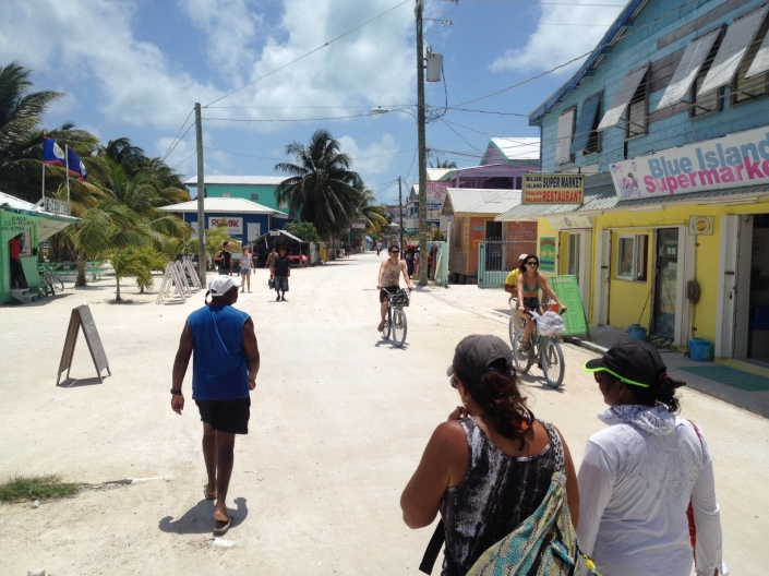 Chunky (in blue shirt), Ruthie and Rose walk the main street of Caye Caulker.
