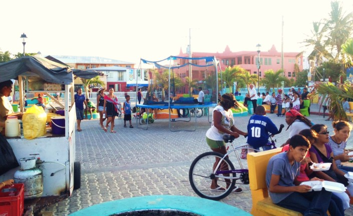 Take-out dinners, a bounce pad for the kids, Belize artisans selling wares and  and old friends sitting on park benches -- Central Park in San Pedro was the spiritual and emotional core of the town on Friday.