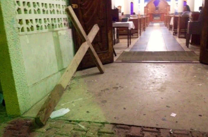 It is nearly 4 a.m. on Friday -- Good Friday -- and the cross that will be carried through the streets of San Pedro Town for the Stations of the Cross rests just inside the entrance to the Roman Catholic Church.