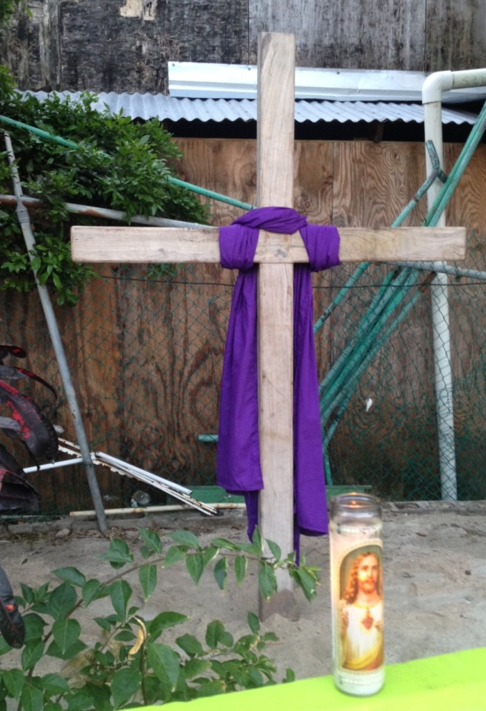 Back at the Catholic Church, the cross is returned to the garden in the courtyard.