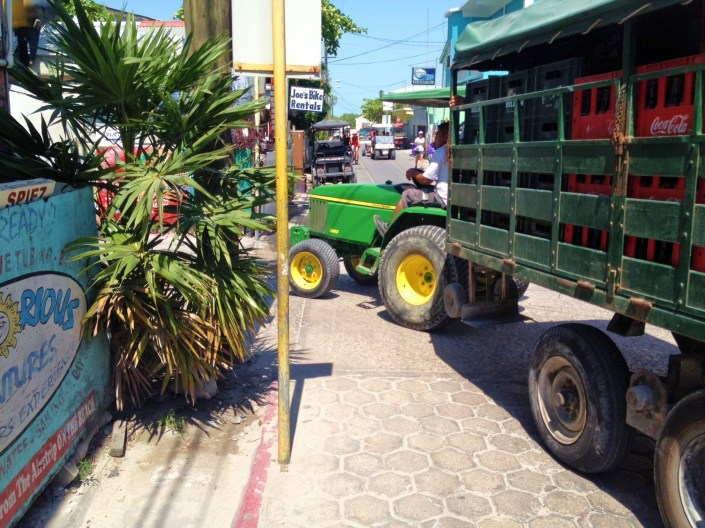Where would Bowen & Bowen be without John Deere tractors to haul Belikin beer, Crystal water and juices and Coca Cola around San Pedro Town? Worse, where would we be without our water and beer? I suspect that the tractors are as much tradition as a very practical way to get round the town's narrower streets.