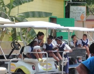 A leisurely lunch outside the walls of the Roman Catholic Elementary School in San Pedro Town.