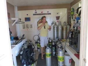 Marty O'Farrell filling air tanks. He's the consummate island diver and has been instrumental in charting many of the underwater caves that lace the islands. (Photo courtesy of the Belize Cave Diving Society)