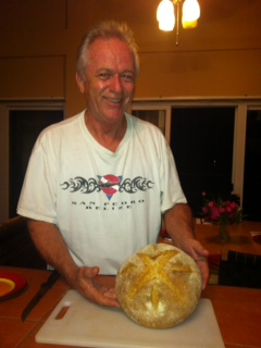 Mike poses with his loaf of fresh-baked artisan sourdough bread.