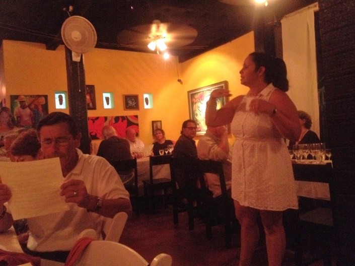 Flor from Wine De Vine previews the next wines that will be poured and how it fits in with the next course to be served at Casa Picasso during a special dinner Saturday night for about 120 guests.