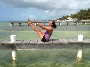 Rose practicing Pilates on a dock just north of our home during our Monday  bicycle ride north.