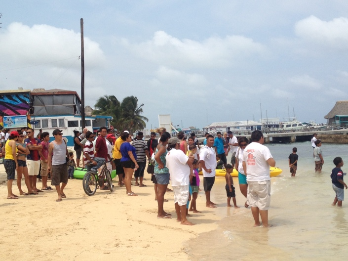 The finish of the 42-mile, two-day Eco-Challenge kayak race around Ambergris Caye drew a big crowd to see the boats cross the finish line in front of Central Park, San Pedro Town, Belize.
