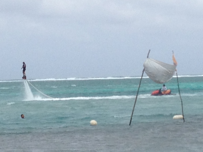 Flyboarder greets finishers in the Eco-Challenge kayak race.