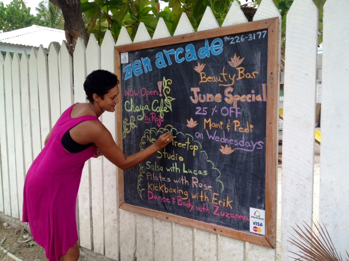 Tara Darrell of Zen Arcade tries to keep up with all the developments on the chalkboard posted out front.