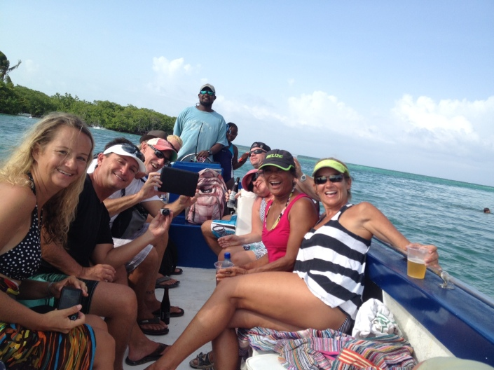 The happy crew of the good ship Newt, with captain Carl at the helm. This is actually at the end of  the day on Caye Caulker.