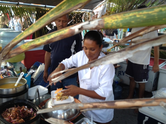 Chef Maresha from Pirate's Treasure prepares a lobster in mango sauce dish at LobsterFest.