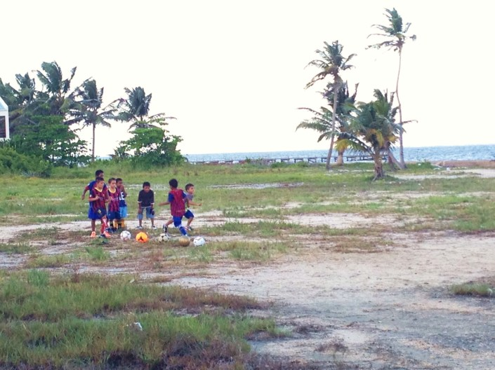 A young futball team practices on the open field across from our condo complex just north of the Sir Barry Bowen Bridge in San Pedro, Belize.
