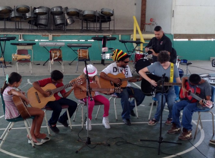 Young guitarists perform at the graduation concert for San Pedro Summer Music Academy 2014 at SP High School on Friday.