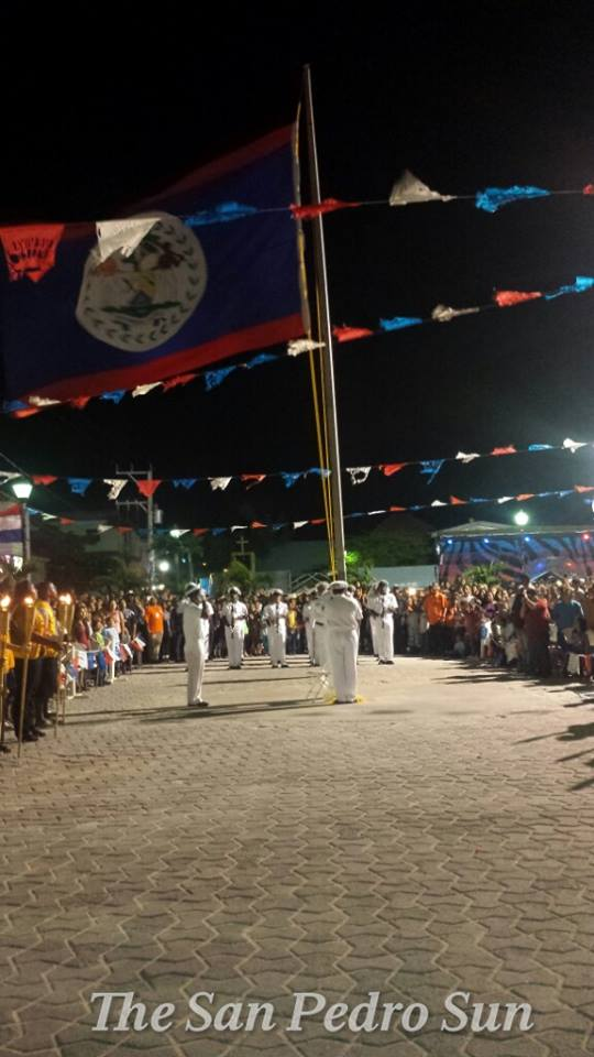 Raising the flag at midnight for Independence Day in San Pedro, Belize. (Photo from San Pedro Sun)