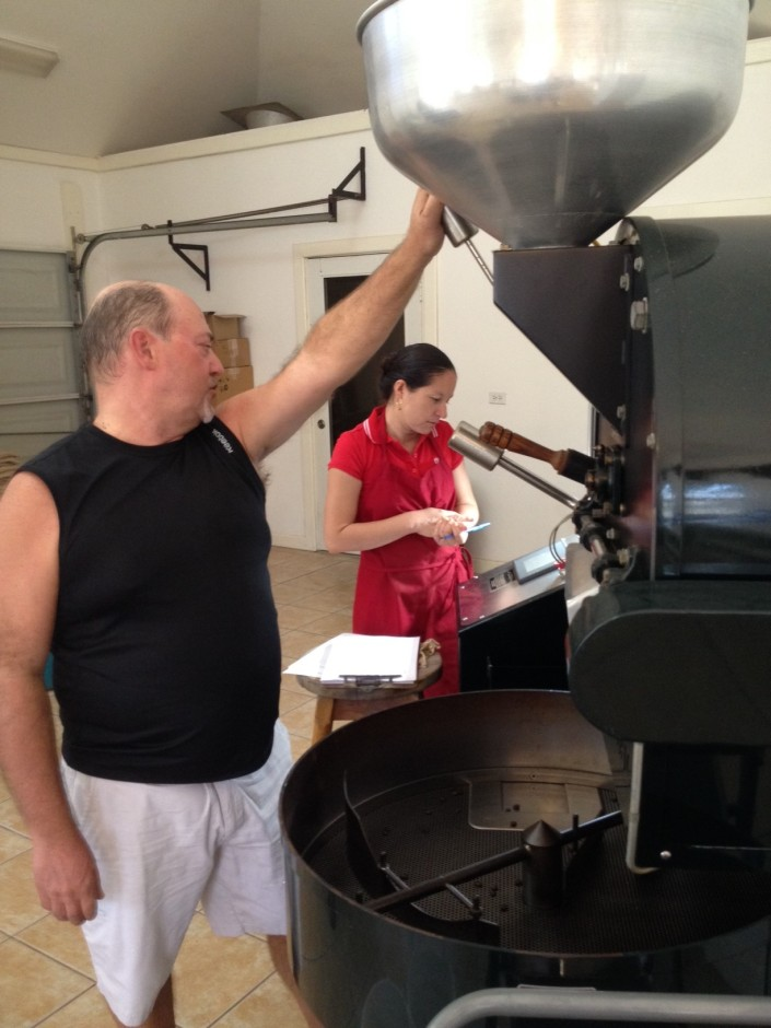 Paul DuVille and Amarilis Polanco consult on the timing  for a roasting batch of Back Street.