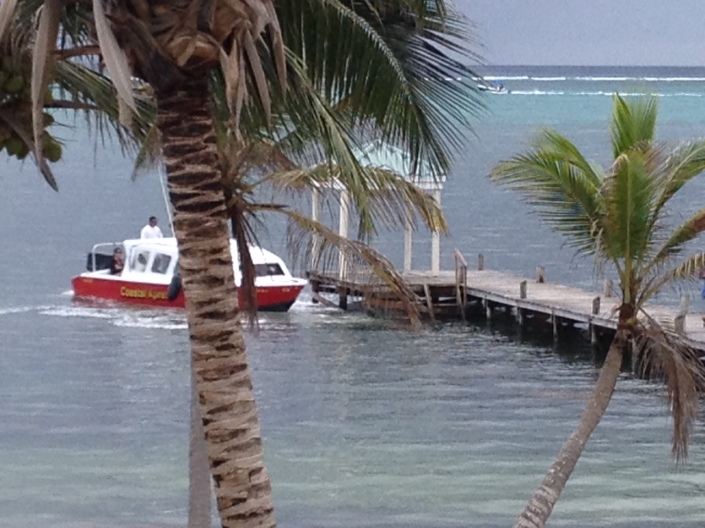 A water taxi pulls in to our dock. One of the coolest ways to get around the 24-mile long island, especially to homes and resorts to the north of San Pedro Town.