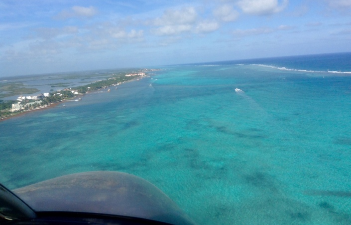 En route to the mainland, first pointing northward before turning west. Just by chance, our condo complex showed up in this image, at lower left. To the right is the great Belize MesoAmerican Reef system.