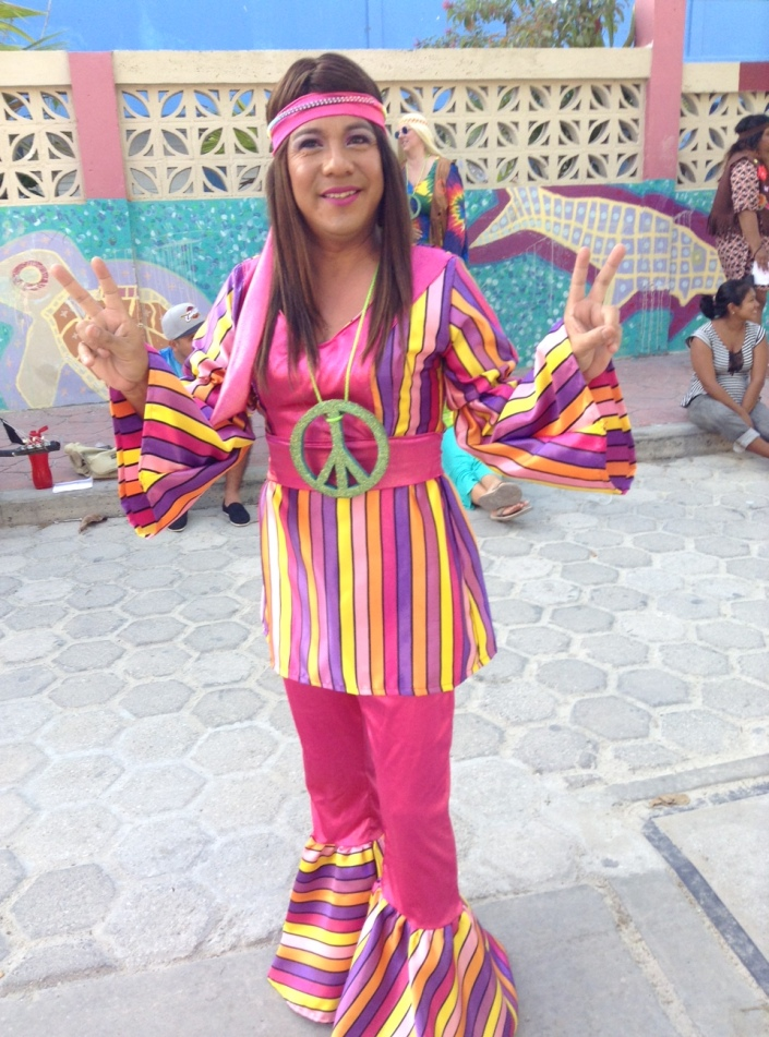 """HIV Commission's Comparsas group prepares to march on Sunday, under the theme """"Hippies come to San Pedro."""" Felix, head of the commission (above) said they will have a different theme every night!"""