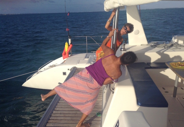 Marlene and Rose try some Impromptu pole dancing on the stern of the catamaran.