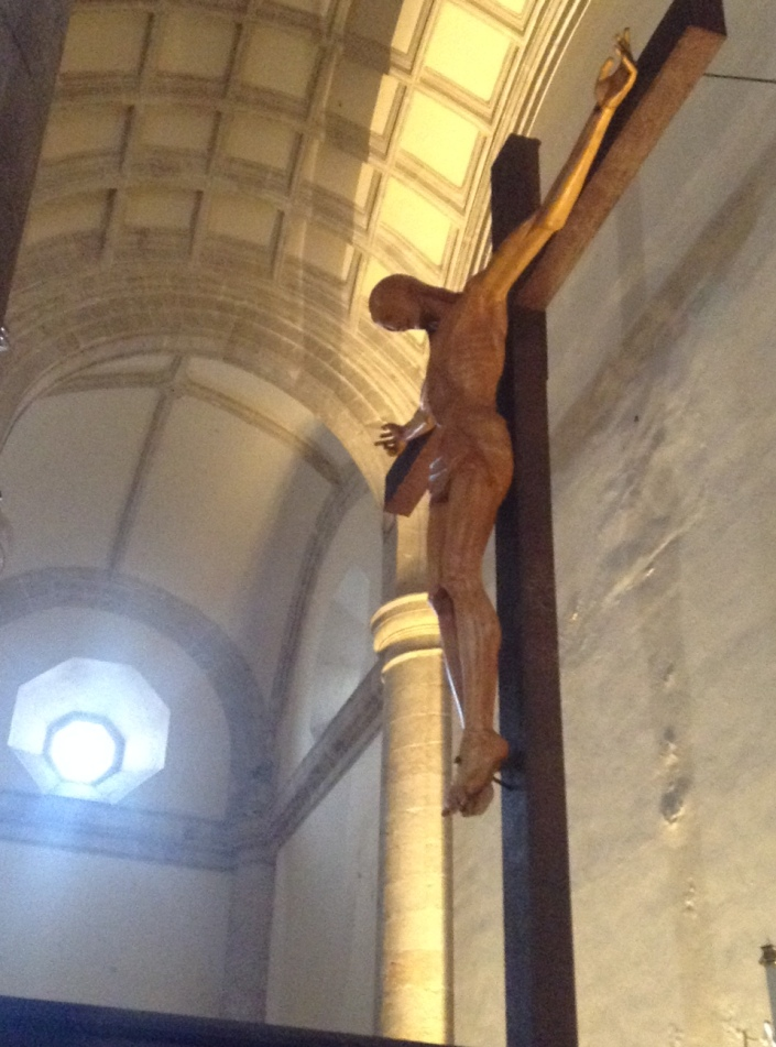 The crucifix behind the central altar in the cathedral, in Merida.
