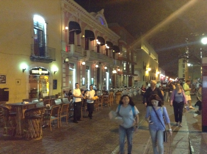On weekends, some streets are closed to traffic and restaurants turn them into sidewalk cafes in Merida.
