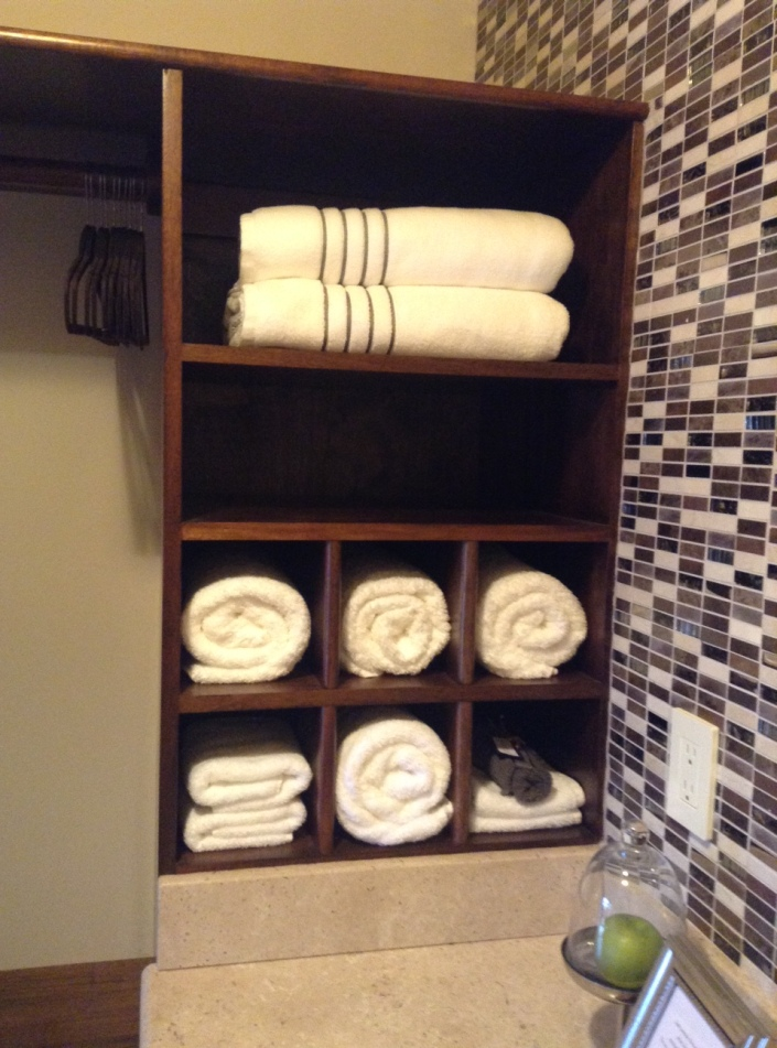 The towel cabinet is almost a work of art. Notice the dark towel lower right, for removing makeup. See? Details.