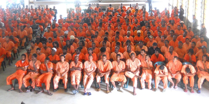 Meet the Class of 2014 at Belize's national prison in Ladyville. Flout the law in Belize and these guys could be your best pals for a while.