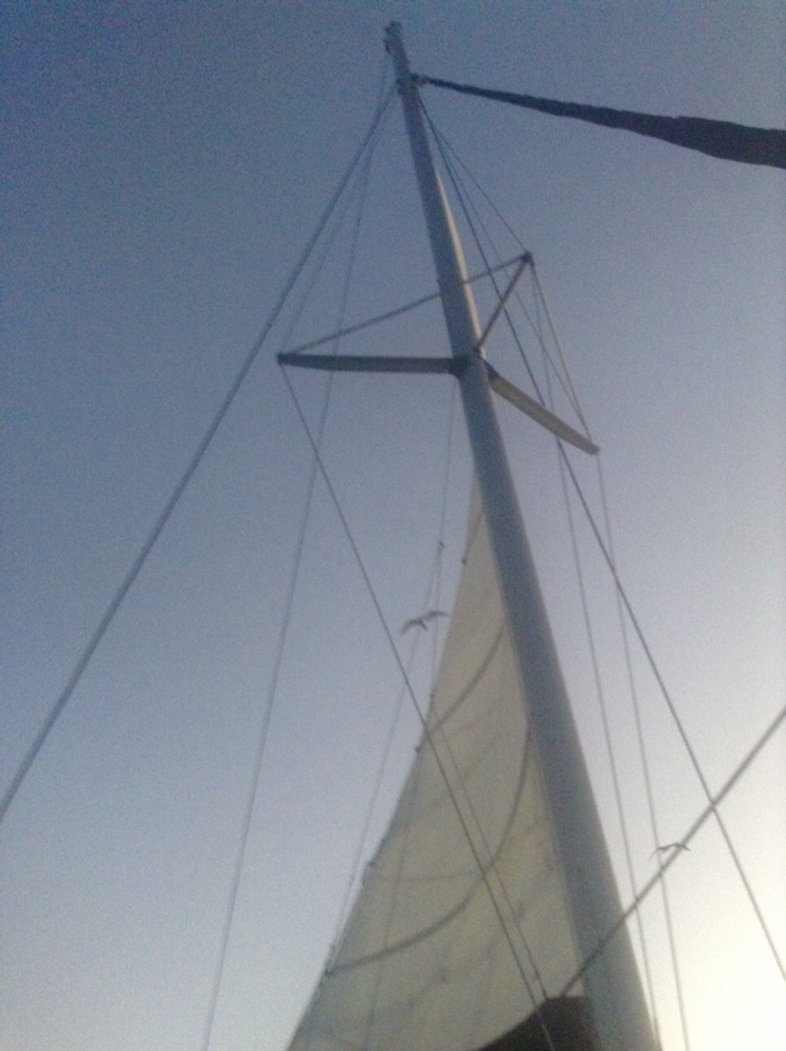 Flat on my back, under full sail, watching the frigate birds drifting in and out of the mainsail draft.