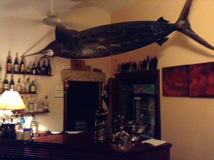 The bar at the Rondezvous restaurant, a few miles up the coast from us. It takes a certain quirky vision to combine a marlin and surfboard. That's just part of what I like about this place.
