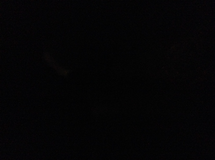This is a picture of me in my living room, late in the evening, with the power out. I guess I should have used a flash.