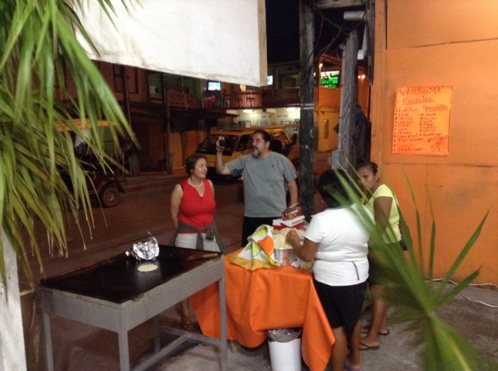 Our friends John and Laurel are intrigued by the ladies making papusas at the entrance to the new Waruguma restaurant on Back Street.