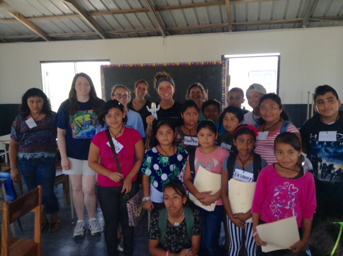 Some of the Holy Cross summer school students and volunteer teachers gathered for a group photo around mid-week.