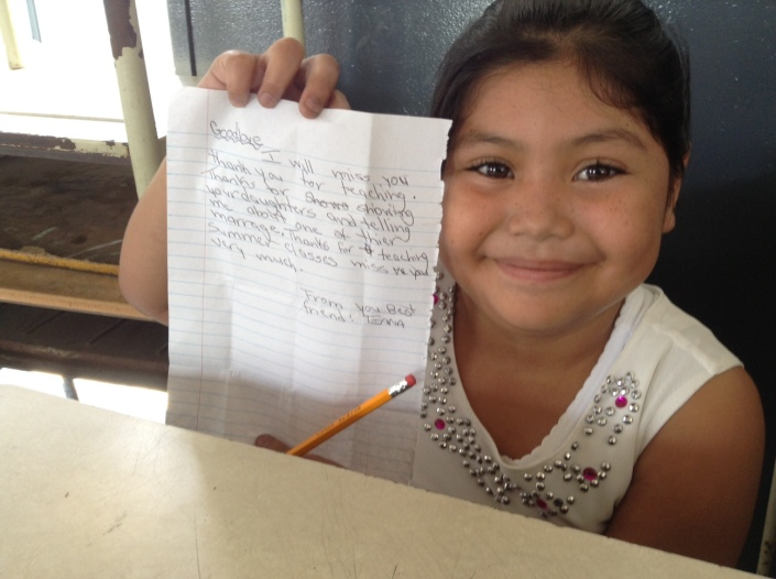 Tatiana holds up the note she wrote to me, thanking me for teaching this week.
